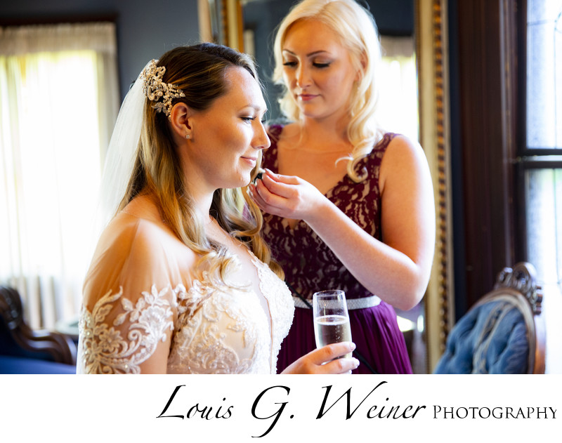 Sisters getting ready at Christmas House and Garden Wedding