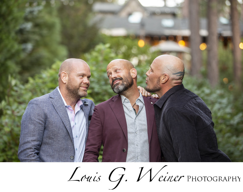 Groom and Brothers portrait at wedding having fun