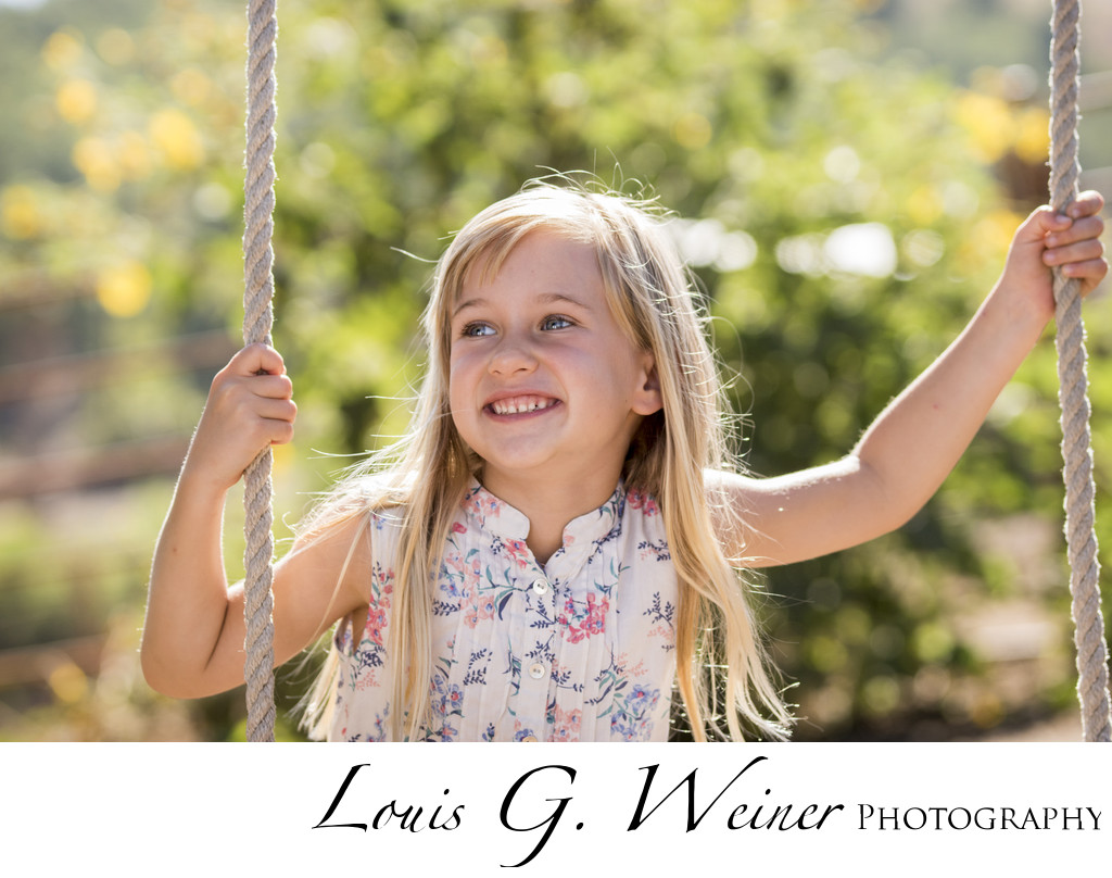 Young lady portrait at Green Spot Farms on a tree swing