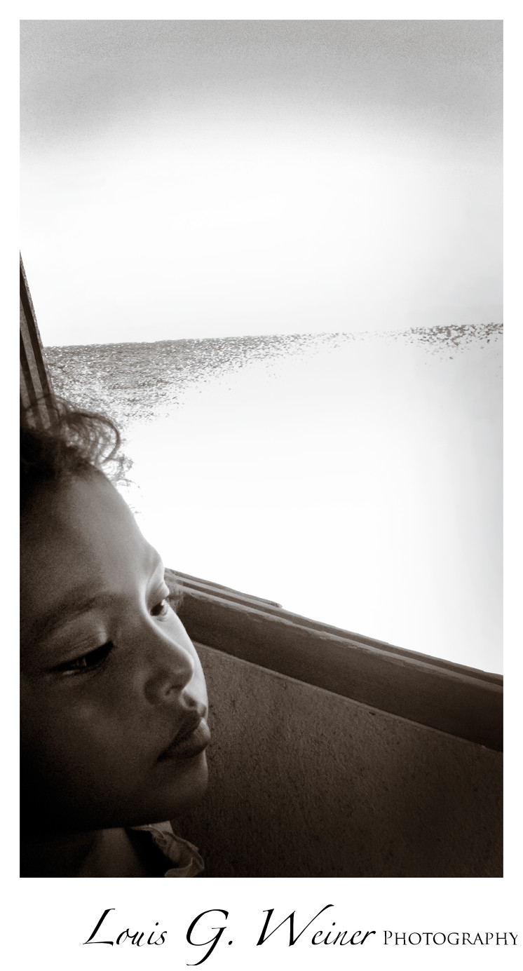 Little girl on boat to Caye Caulker in Belize, Travel Photography