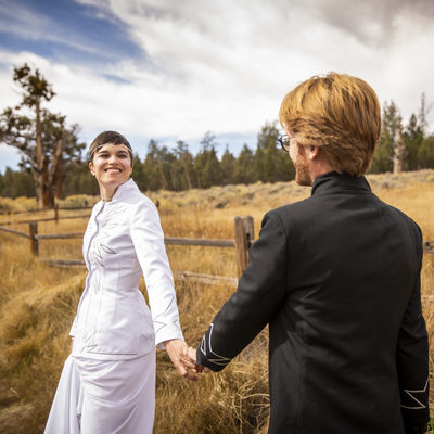 Bride leading her groom at Wedding at Gold Mountain Manor