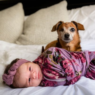 Baby and her sweet dog, one eyed dog so not winking