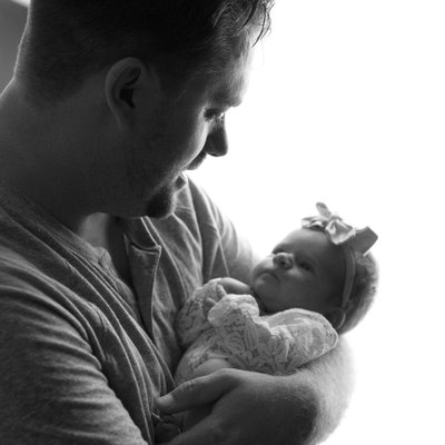 Sweet new born and father lifestyle portrait