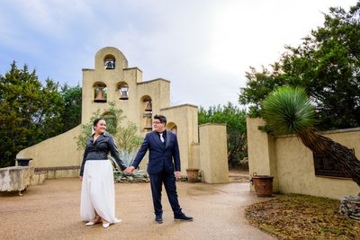 Chapel Dulcinea | Bride and Groom by Bell Wall