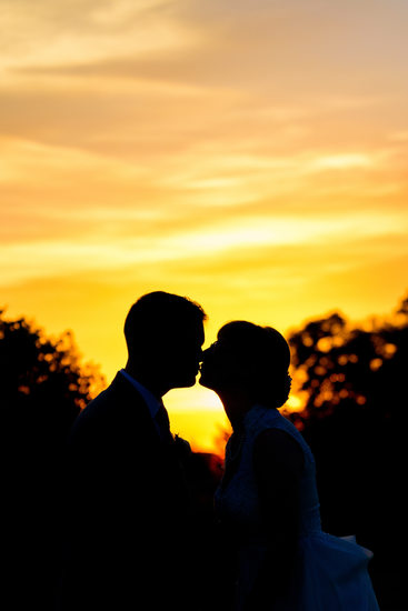 Sunset Kissing Silhouette Wedding Photograph