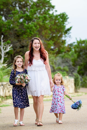 Chapel Dulcinea | Bride Walks Down Path with Daughters