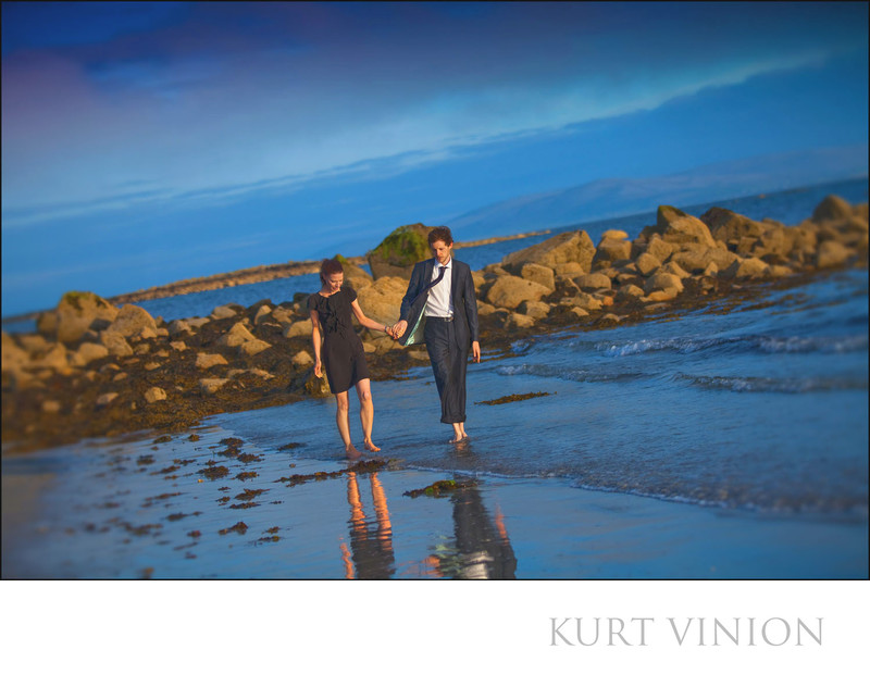 walking barefoot in the sand beach couple engagement