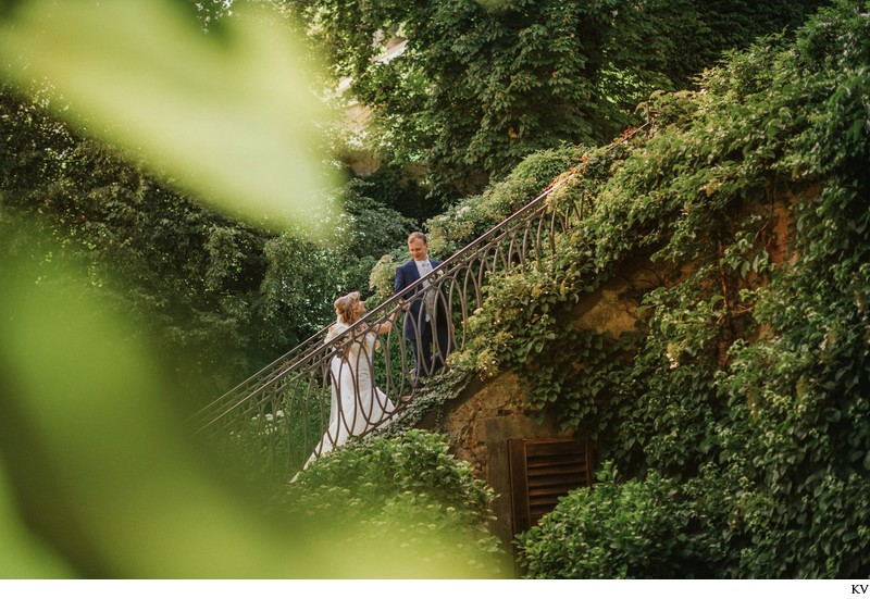 leading his bride up the Ledebour steps