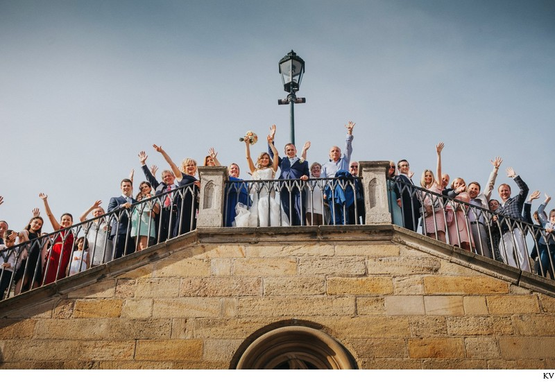 The happy wedding party at the Charles Bridge