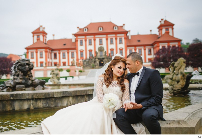 wedding couple sharing moment Prague Troja Chateau