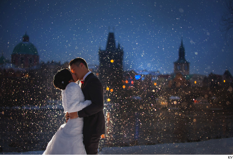 a winter kiss in the snow Charles Bridge at night