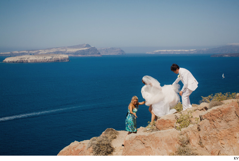 hiking to the perfect spot from a Santorini wedding