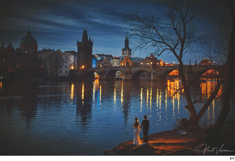 romantic artistic image couple Charles Bridge night