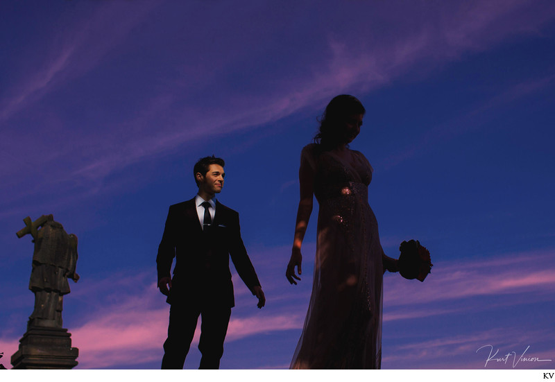 couple statue sky Prague authentic wedding day photo