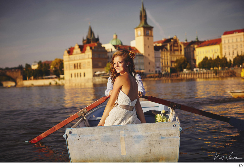 newlyweds in the rowboat - Prague destination wedding