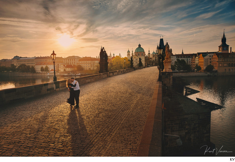 Fine art photo romantic couple embracing Prague sunrise