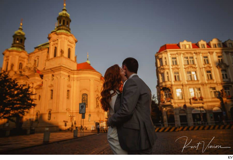 a laugh as the rising sun lights up Prague's Old Town