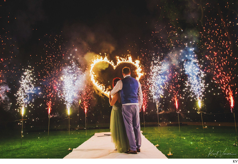 wedding couple watches Fire Show Chateau Mcely
