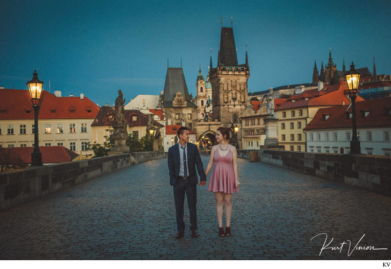 M&S walking through Charles Bridge twilight hour