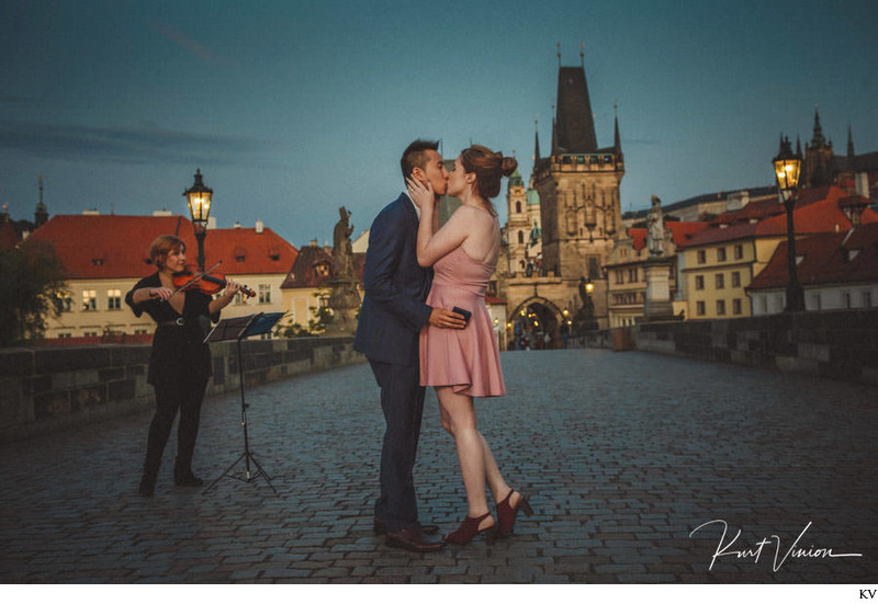A kiss for the newly engaged Charles Bridge twilight