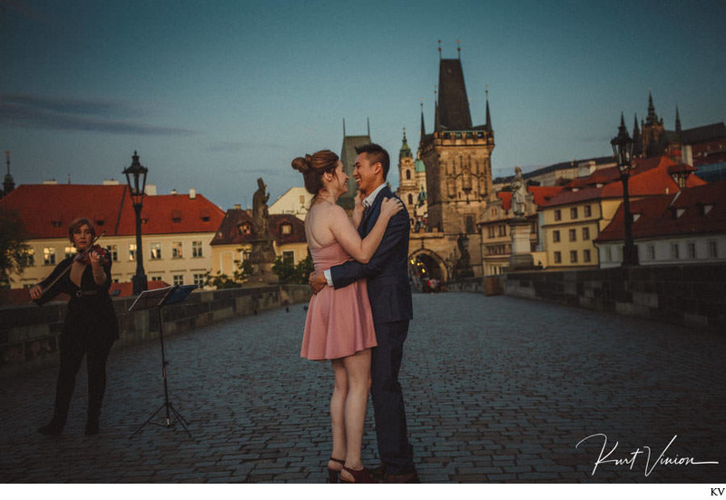 happy newly engaged Charles Bridge marriage proposal