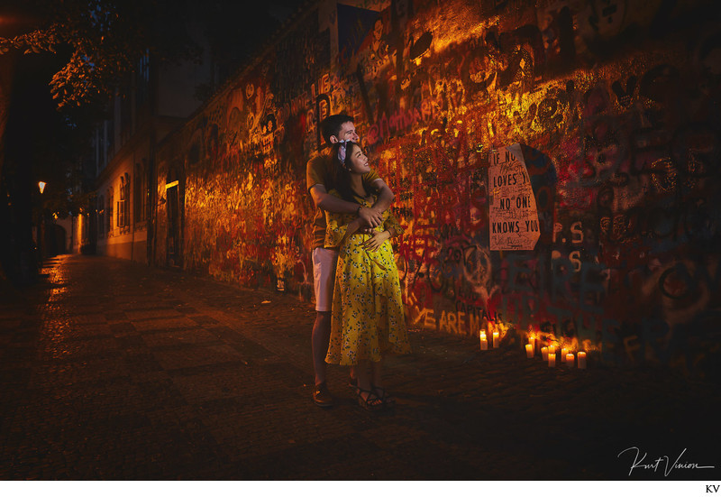 A candlelit John Lennon Wall Prague Engagement photo