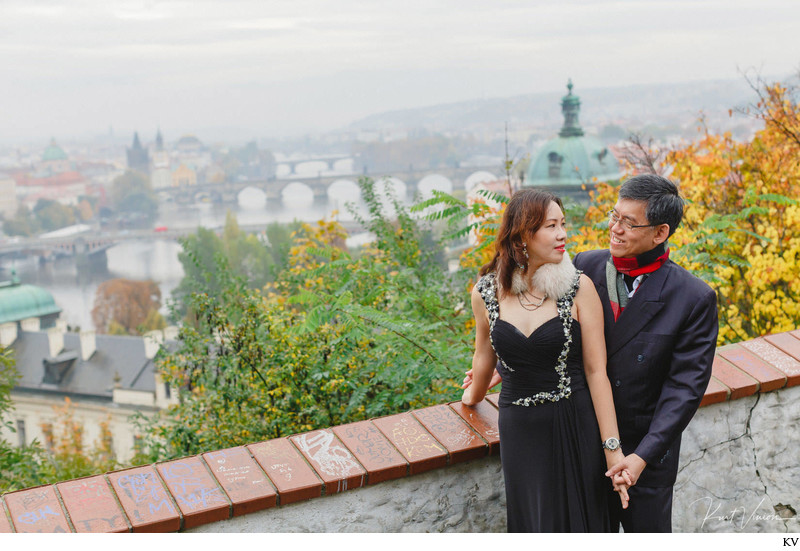 A portrait of the mom & dad overlooking Prague