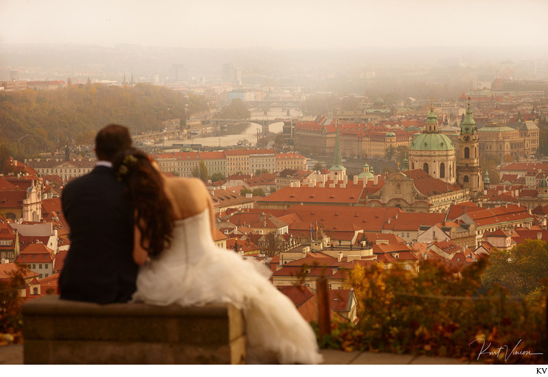 wedding couple enjoy romantic view above Prague