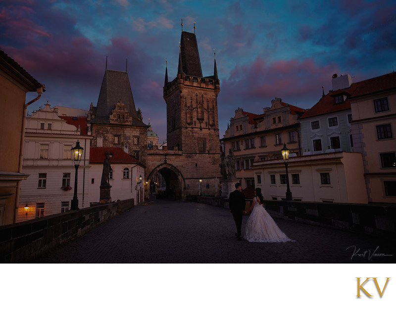 walking in Prague at twilight atop the Charles Bridge