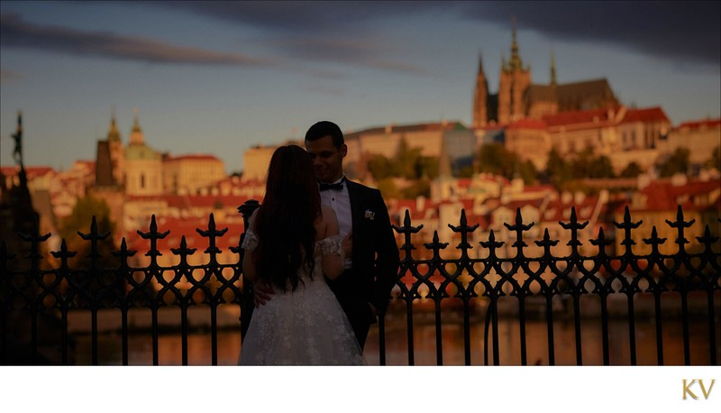 Bride & groom enjoying sunrise near Charles Bridge