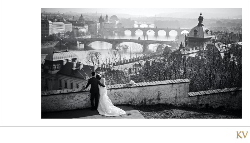 elegant b&w portrait  bride & groom overlooking Prague