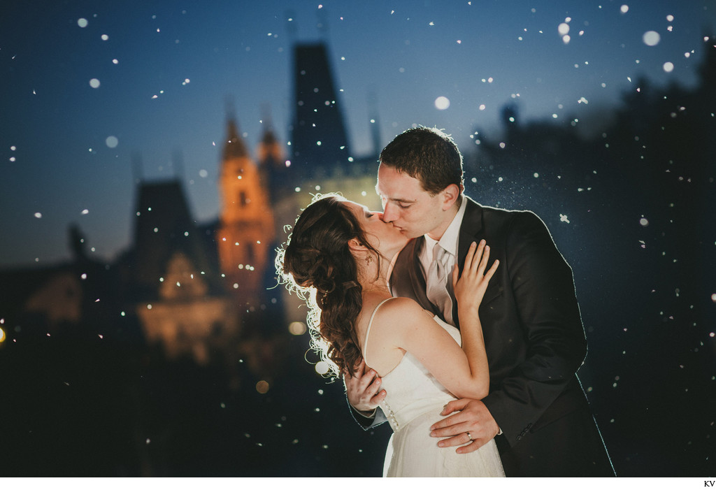 magical kiss of bride & groom Charles Bridge at night