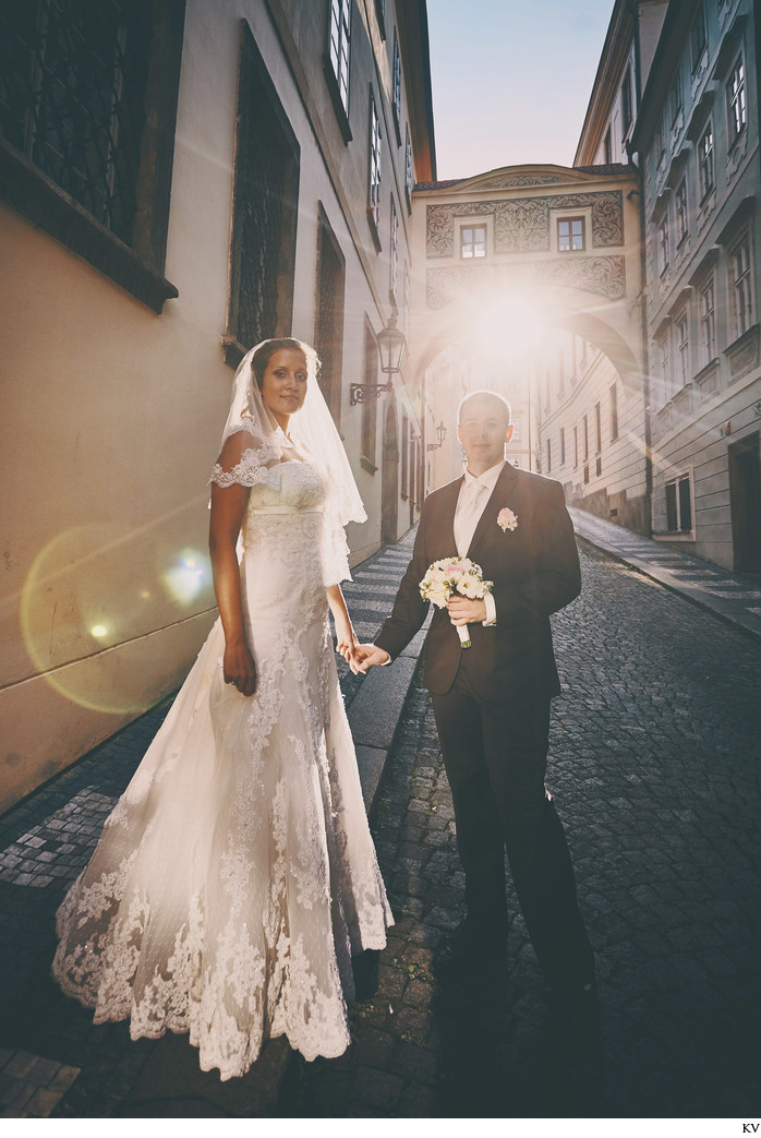 magical sun flare elegant couple - Prague wedding photo