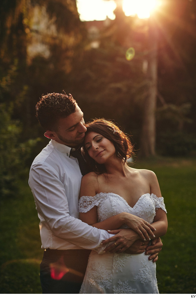 lovers embrace secret garden sun set - Prague wedding