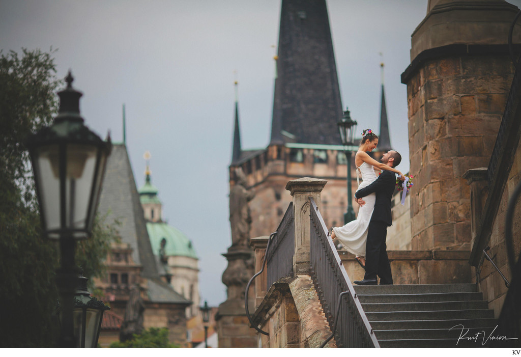 newlyweds celebrating at the Charles Bridge