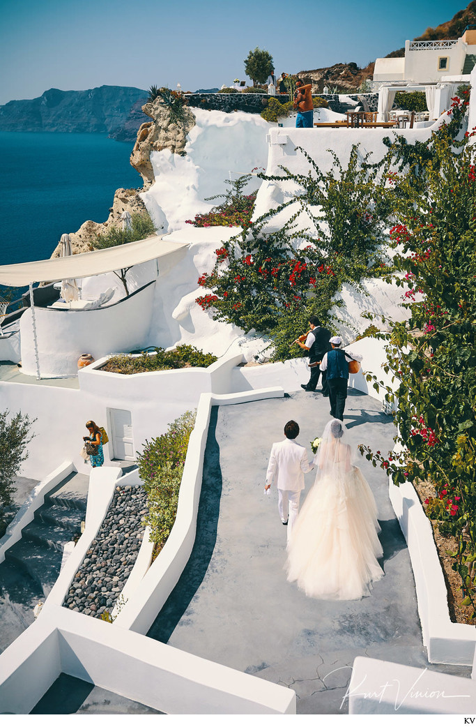 musicians lead the wedding couple Santorini wedding
