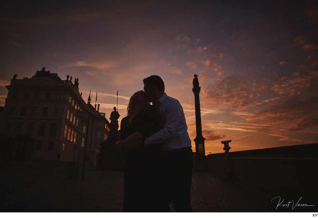 Christie & Michael snuggle at Prague Castle at sunrise