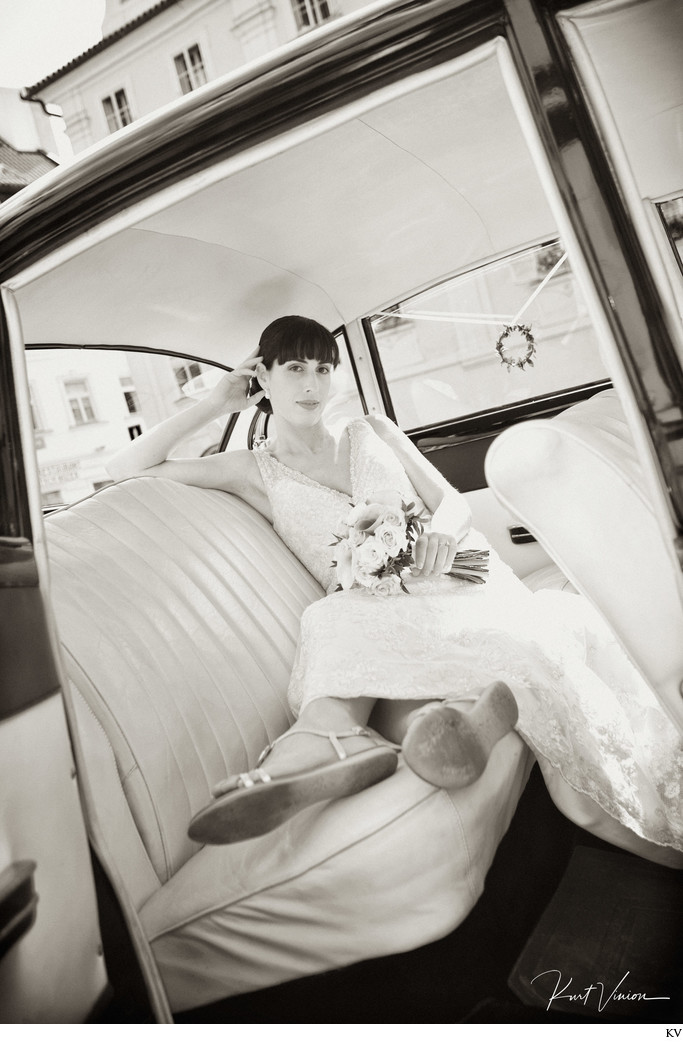 Christine in the vintage BMW from her Prague wedding