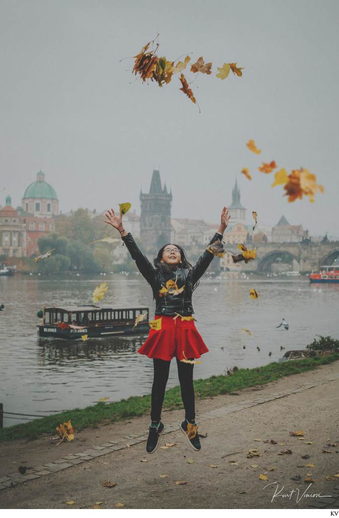 Jumping for joy with the Autumn leaves Charles Bridge