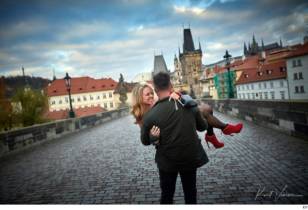 Carrying his girlfriend across the Charles Bridge