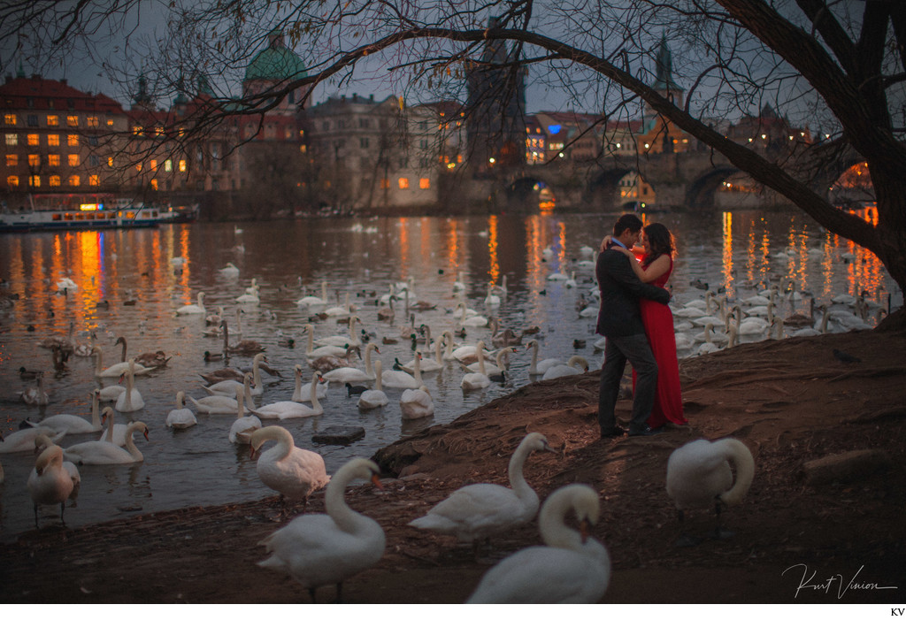 winter engagement photo Prague riverside