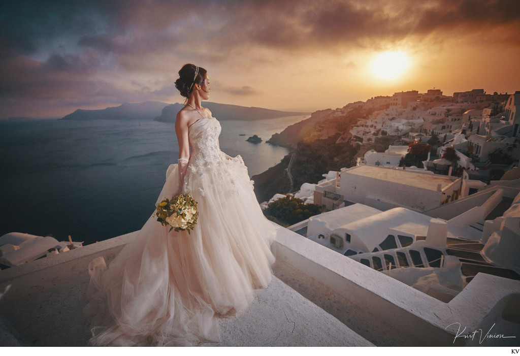 Bride watching the sunset in Santorini