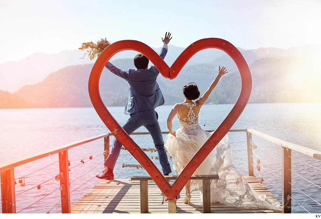 Jumping for joy with the 'Heart of Bled' wedding couple