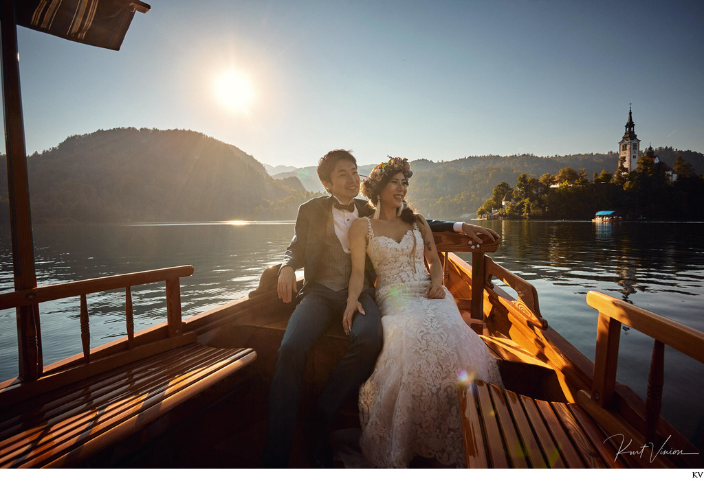 Lake Bled bride & groom couple enjoying boat ride