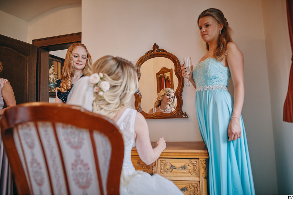 bride checks herself in mirror Castle Hluboka weddings