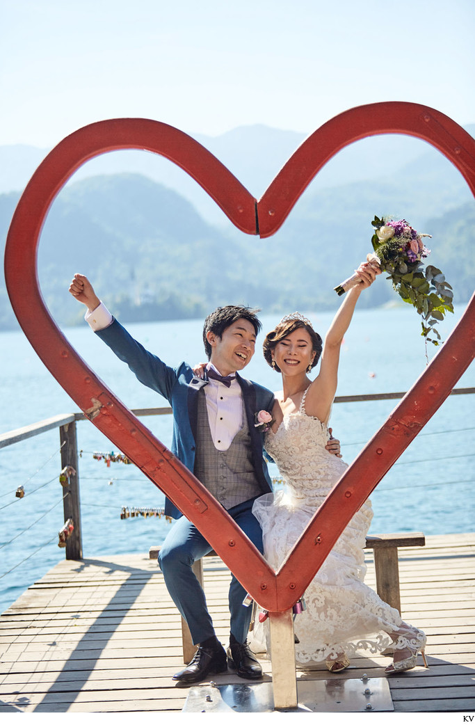 Lake Bled weddings I bridge & groom 'Heart of Bled'