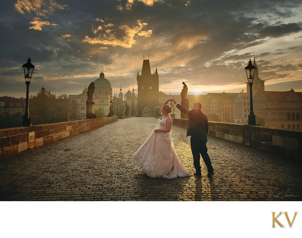 bride & groom dance at sunrise Charles Bridge