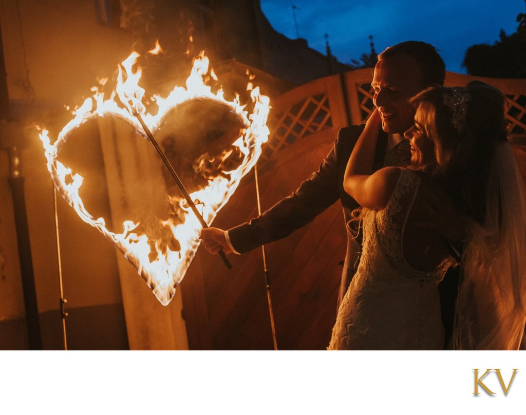 A hug and a kiss for the groom as a heart burns