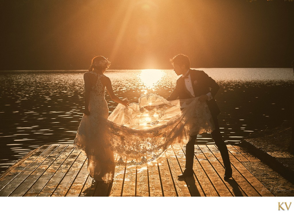 Lake Bled weddigns fixing the brides dress Golden Light