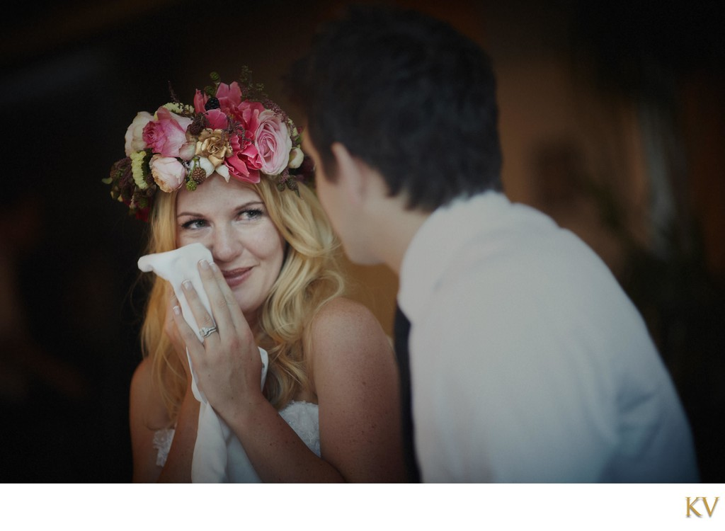 a brides tears of happiness as she smiles to her groom